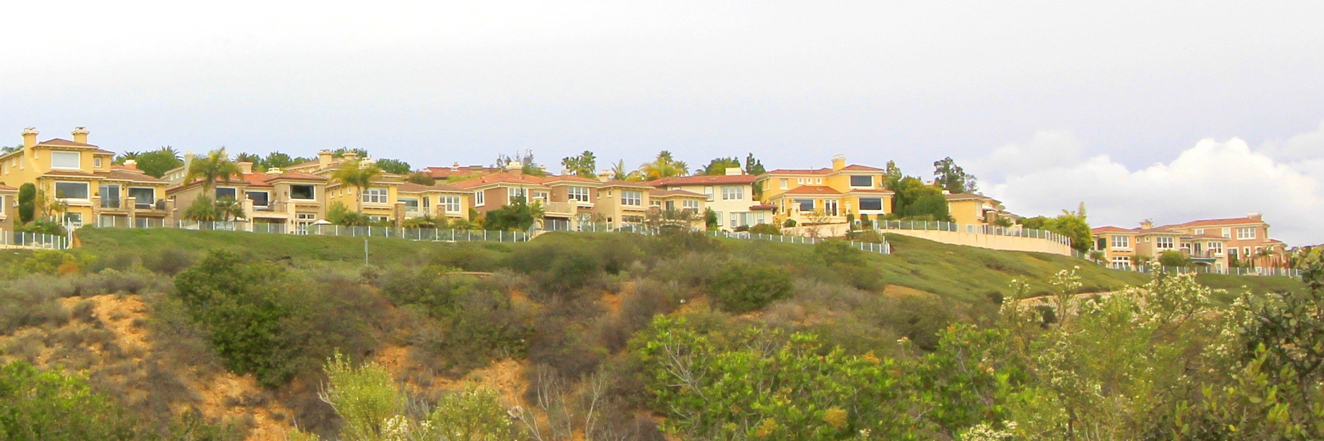 Pelican Ridge is a gated hillside custom home community in Newport Coast CA