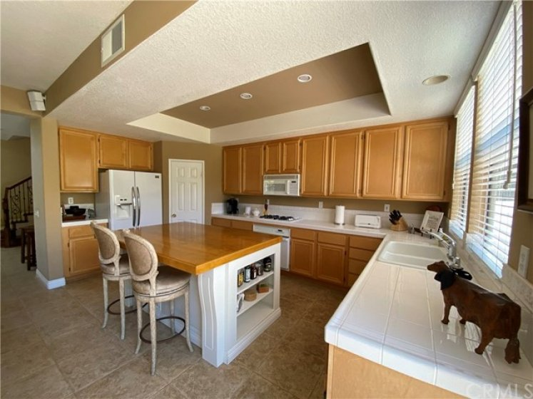 Kitchen Features Recessed Ceiling And Plenty Of Counter Space.
