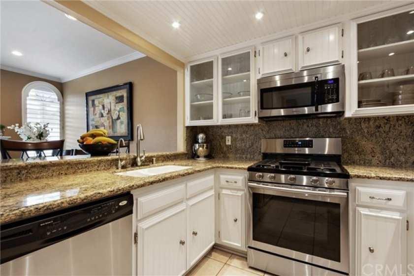 Custom glass front cabinet doors and built in microwave oven make this kitchen a cherrful place to prepare those family meals. The wide opening leads to the dining room where you can enjoy a cozy fire while spending quality time with family.