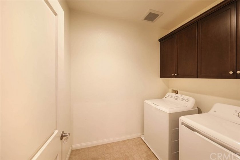 Separate laundry room provides convenience and ease.