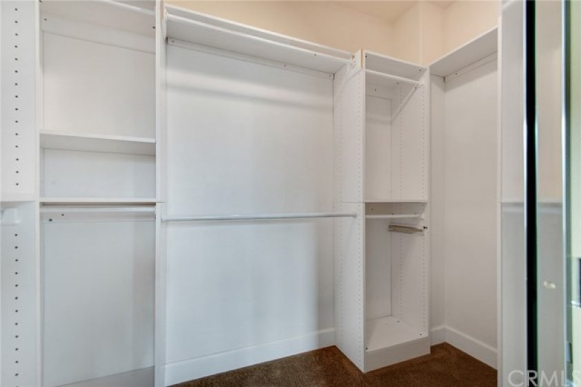 Spacious closet in the master bedroom with organizers