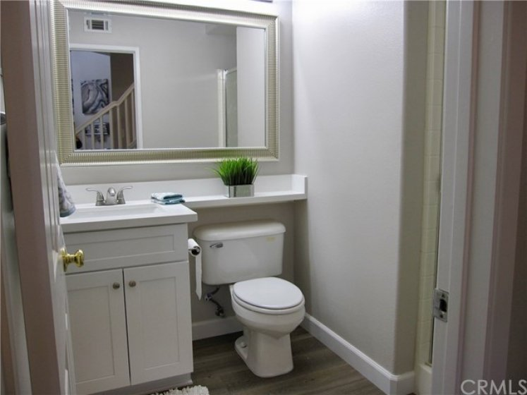 Upgraded downstairs 3/4 bathroom. New shaker cabinet vanity, counters, mirror and flooring.