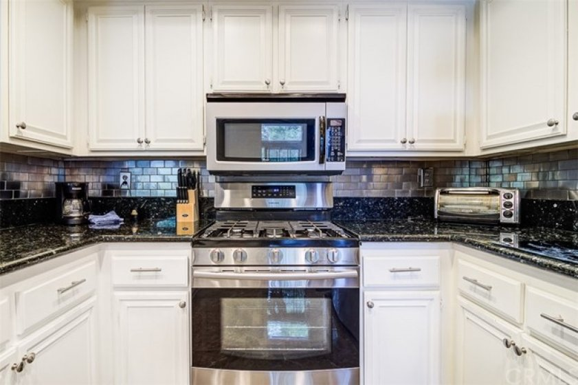 5 Burner Gas Range, Microwave. LOOK at the UNIQUE Backsplash