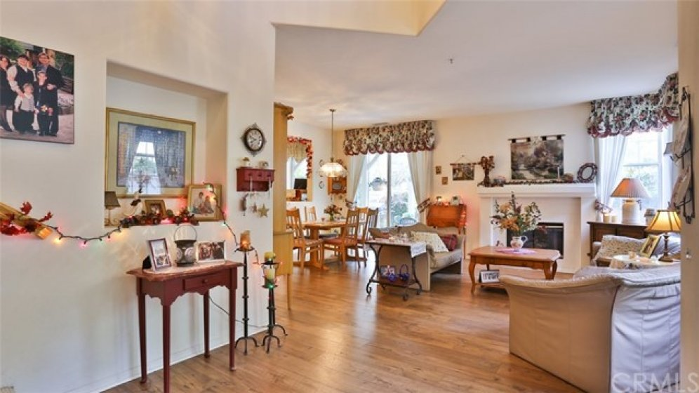 Shared living and dining room warmed by fireplace with large glass slider to back yard... perfect for entertaining!