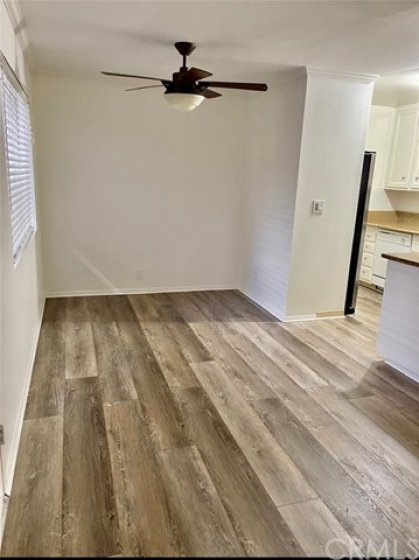 Dining Room with Ceiling Fan and New Plank Flooring