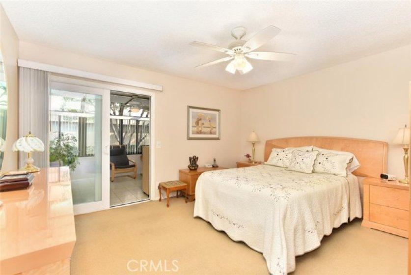 Spacious master bedroom opens to solarium.