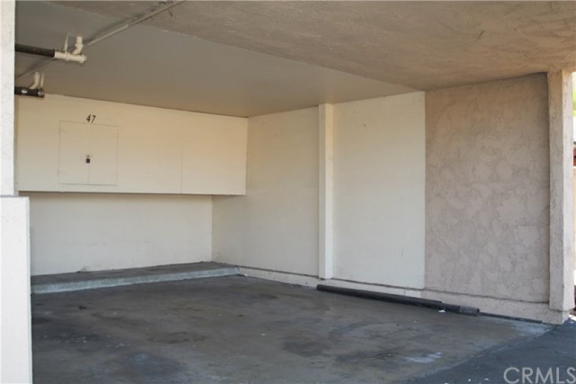 Covered Carport with extra built-in storage