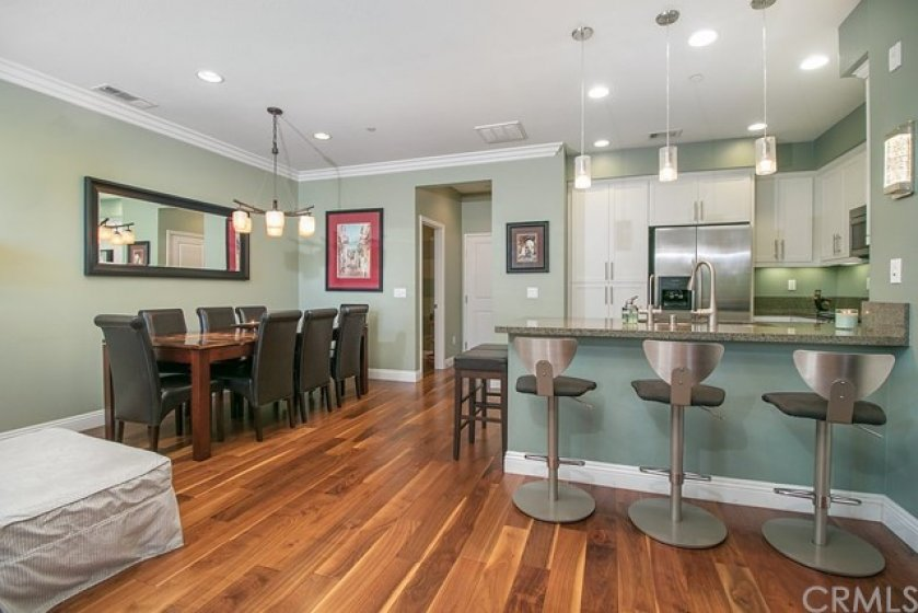 A large dining table fits perfectly in the space.