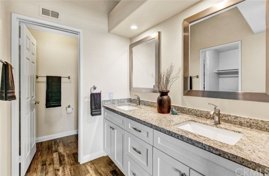Remodeled master bathroom with soft close shaker style cabinets