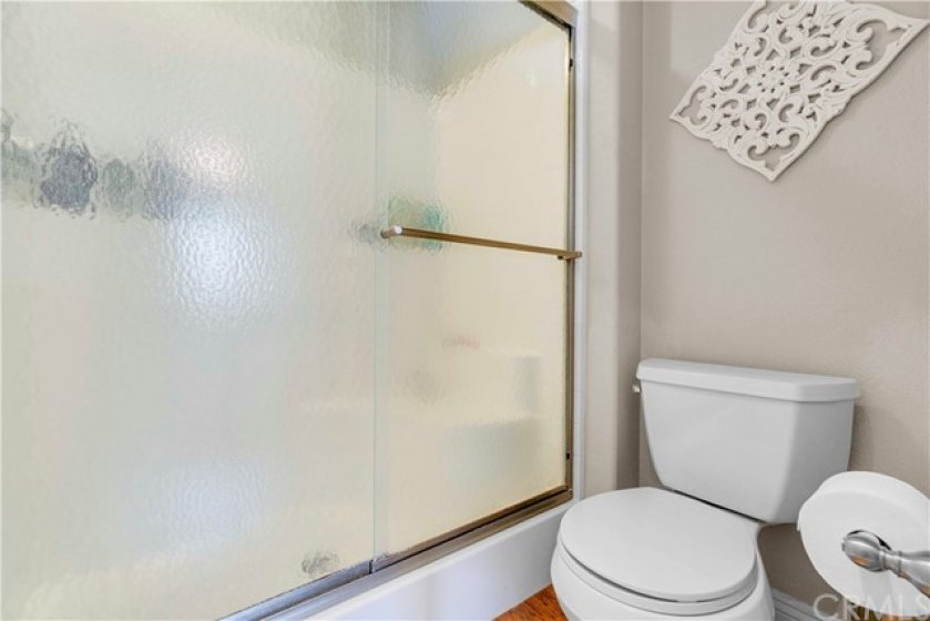 If you prefer a long shower after a day at the pool, step into the walk-in shower with glass enclosure also featured in the front master suite.