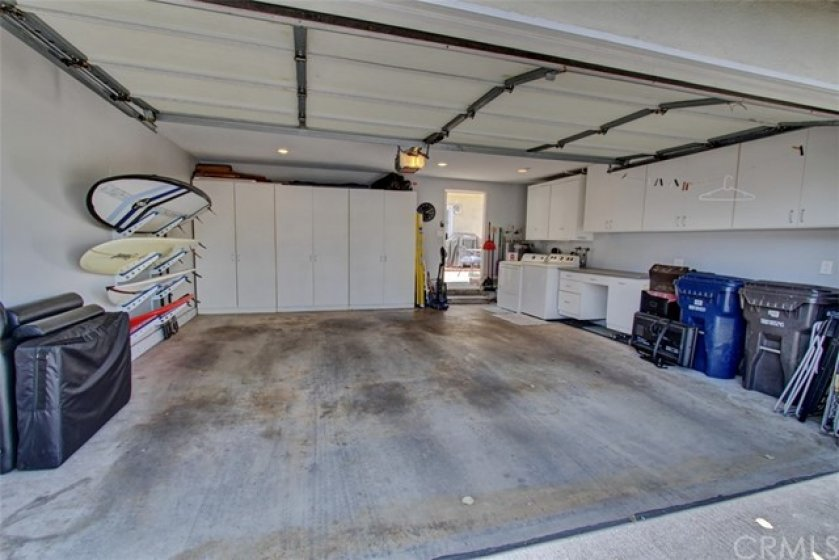 Spacious garage with some built in storage.  Laundry area with plenty of space to fold the clothes.