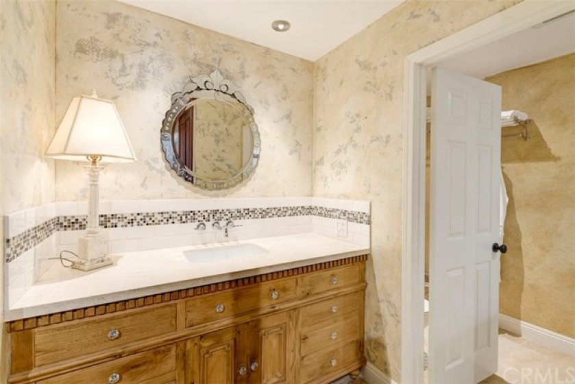 Main Master Suite offers Separate Shower and Roman Bathtub, Custom cabinetry and large closet space