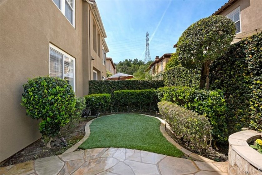 The lush artificial turf adds to the beauty of the easy care yard