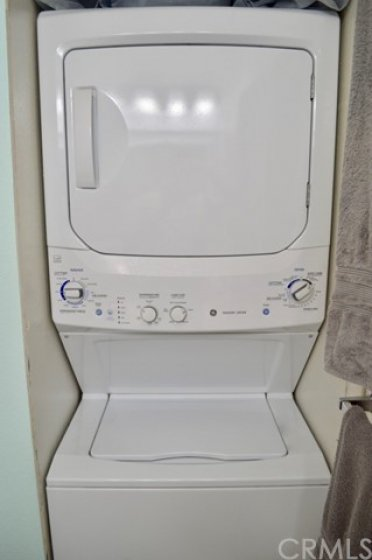 Stacked washer and dryer in the master bathroom. Washer and dryer included in the price.