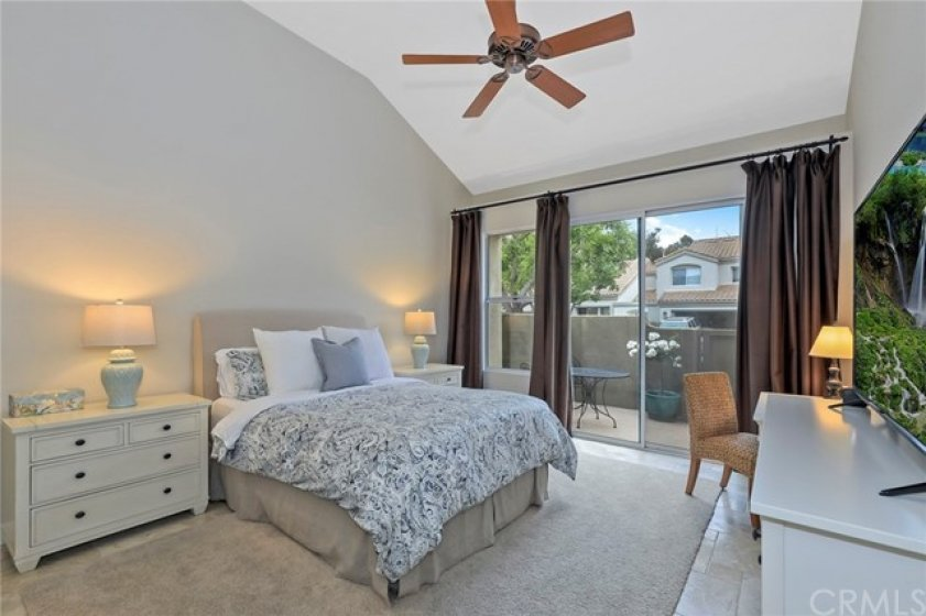 Gorgeous Master Bedroom with Vaulted Ceilings, Private Patio and Ceiling Fan