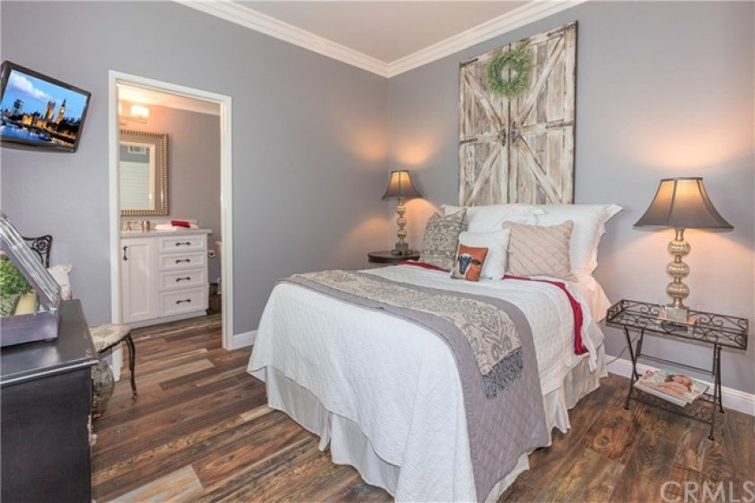 Guest bedroom or office or craft room or kids' room - with plantation shutters, matching sliding wardrobe doors, beautiful crown moulding and upgraded baseboards with seriously lovely flooring throughout!
