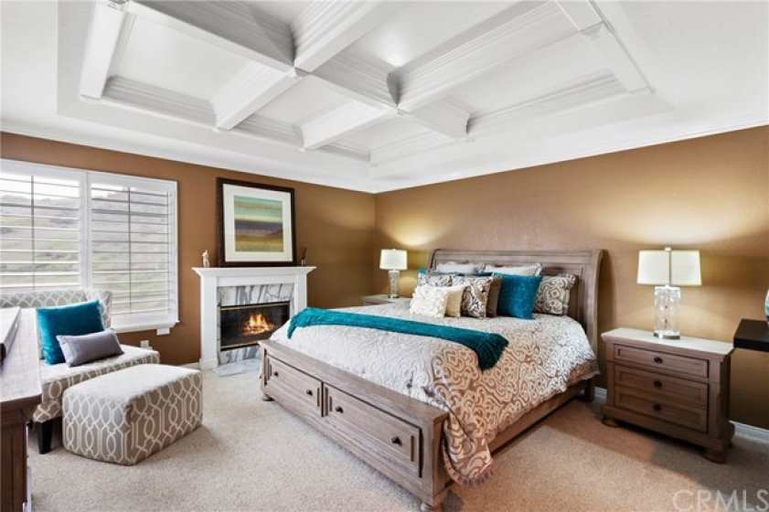 This is a master suite fit for royalty! Lovely coffered ceiling, warm, plush carpet, and a designer inspired paint schema. you may not want to leave this room with a cozy fire in the fireplace. A perfect place for morning coffee!
