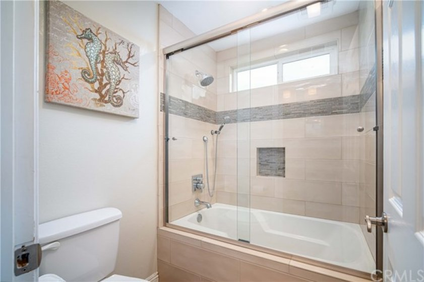 New shower and tub enclosure with custom tile and niche