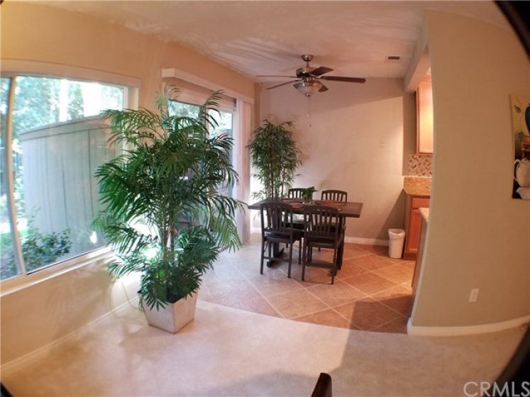Dining room centrally located between living room - kitchen - and sliding glass doors to enclosed patio and deck.