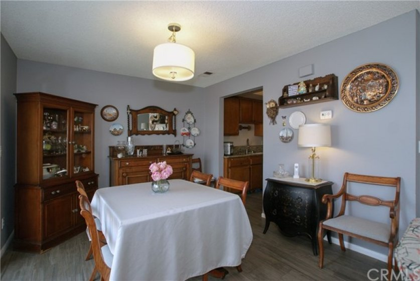 Roomy dining room looks out on private patio