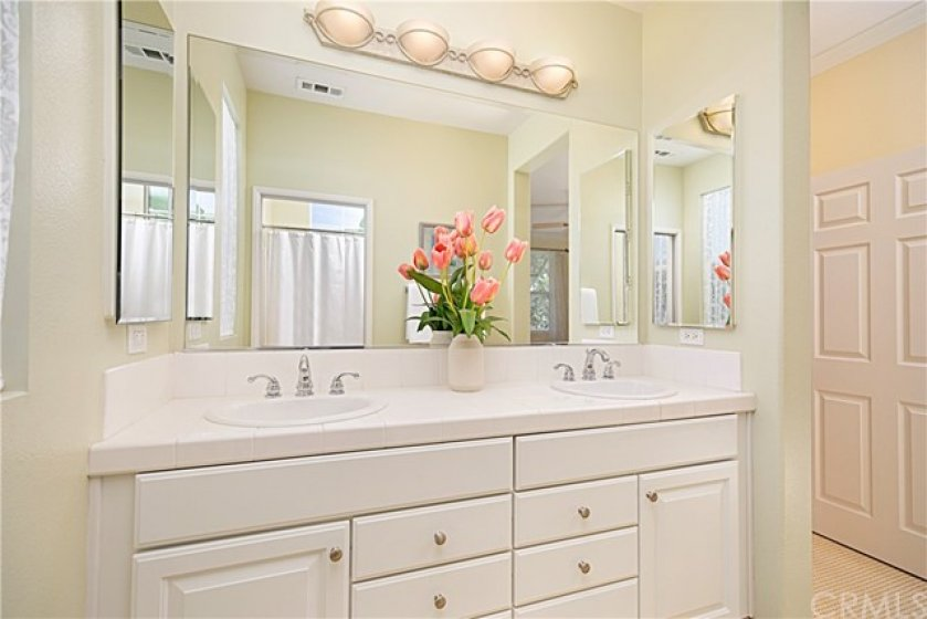 Master bedroom with en-suite boast crown molding, ceiling fan, views, walk-in closet, dual master bathroom sinks, separate toilet & shower area.