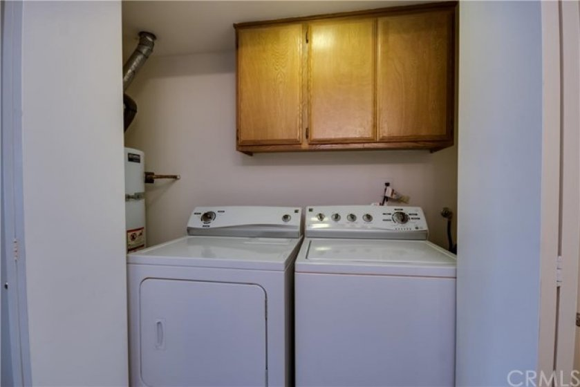 Laundry and water heater in the unit