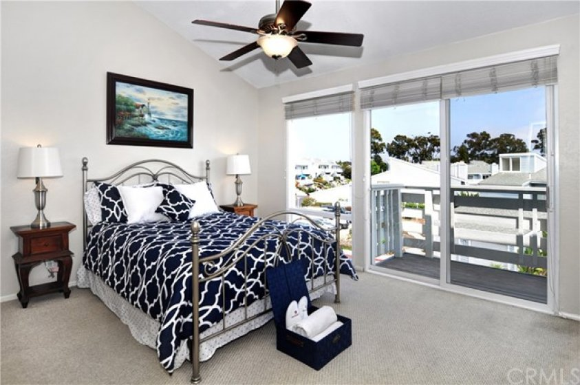 The master bedroom is light and bright with a private balcony so you can sit outside and enjoy the cool ocean breeze.