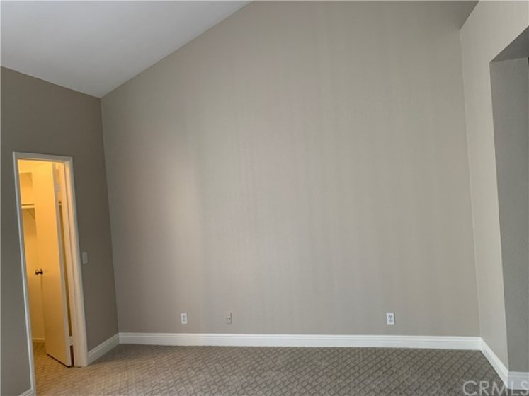 Master bedroom with vaulted ceilings. New designer carpet and paint.