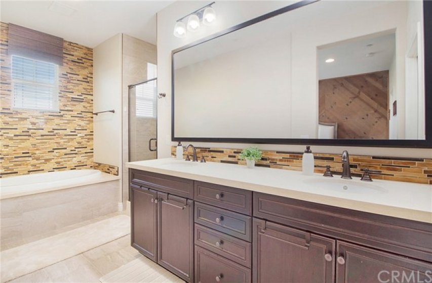 Master bathroom with large soaking tub, separate shower and dual sinks.