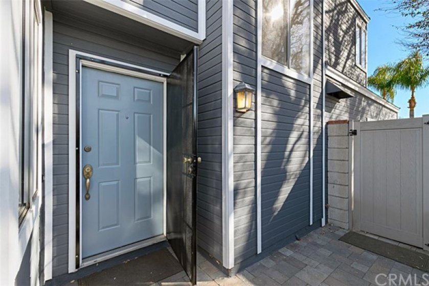 The front door and security screen to Your New Home