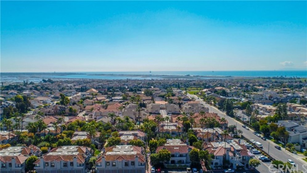 Aerial view of the community, showing proximity to the ocean and Bolsa Chica wetlands.  Only a short bike ride or walk to the beach