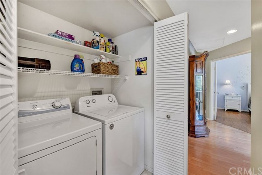 Laundry room conveniently located in hallway and this model is suitable for side by side washer and dryer (included)