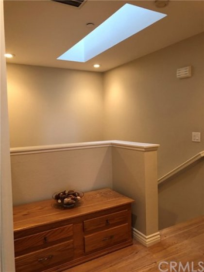 Upstairs Landing...Perfect for a small office area! Note the Skylight.
