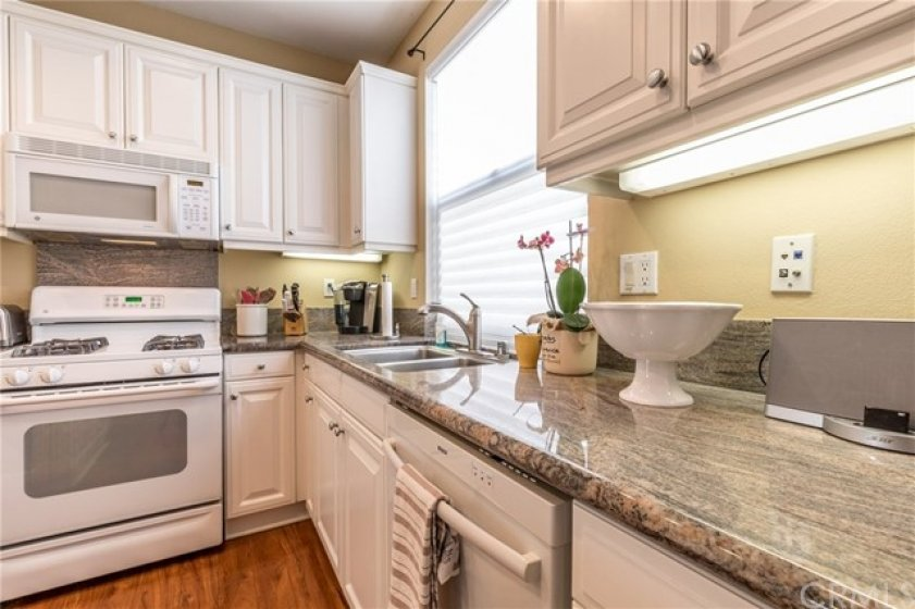 Crisp white cabinets and granite counter tops