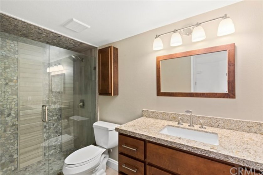 Remodeled Downstairs Bathroom with Beautiful Custom Tiled Shower and Granite Vanity