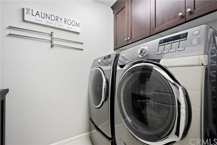Upstairs laundry with storage.
