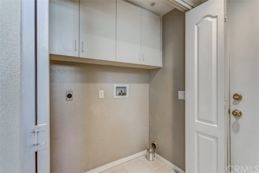Downstairs is a laundry closet with both gas and electric options. Appliances are included, just not pictured.
