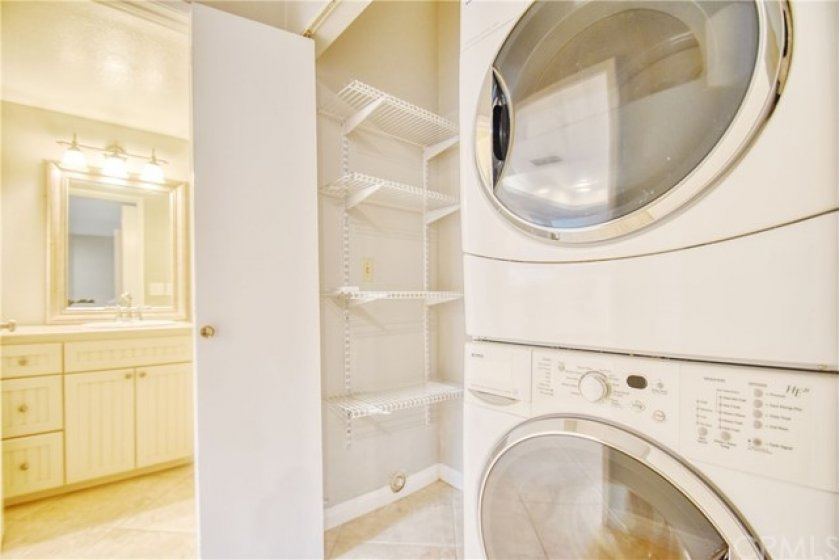 Laundry closet adjacent to half bath on main level.