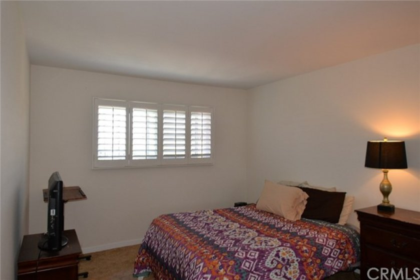 Rear bedroom on the right with plantation shutters.