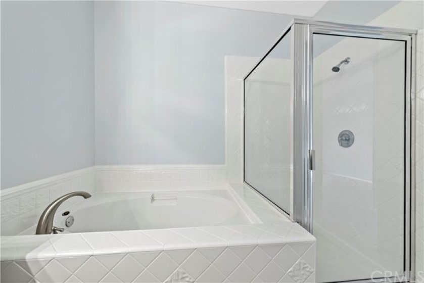 Fresh tile refaces makes this master suite extra fresh and upgraded.