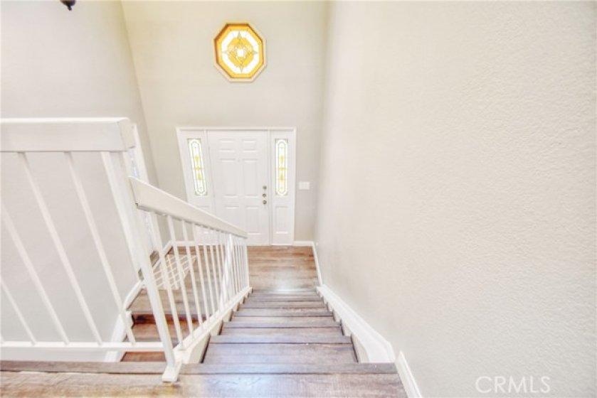 View of front door from master bedroom on split level.