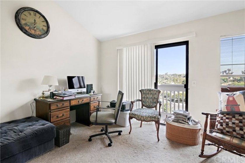 Upstairs office/ den. Lot's of natural light and a fireplace.