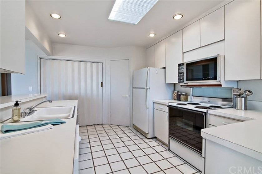 Kitchen with recessed lighting, Washer/Dryer area and walk-in pantry. Skylight to allow plenty of natural light