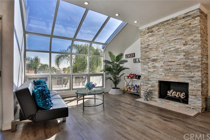 Great window area for ample views and gorgeous fireplace stacked stone!