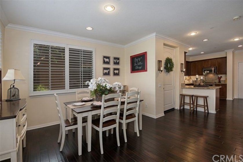 This angle of the dining room shows the easy access to the kitchen