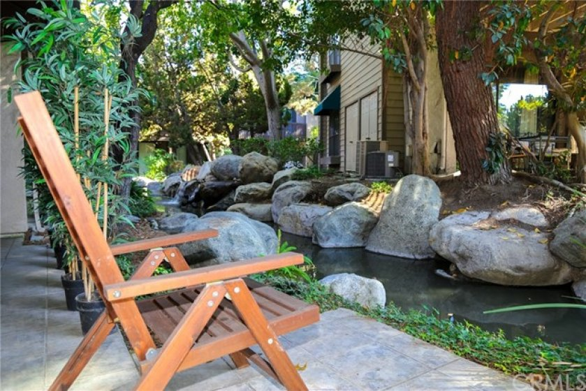 Relax here on your patio and listen to the soothing water