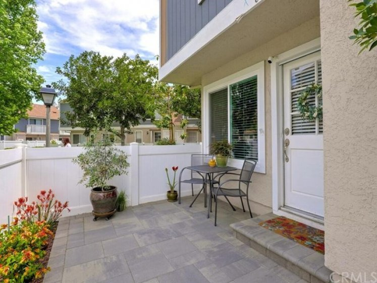 The front patio has gorgeous decorative pavers and a lively garden with room to relax or entertain.