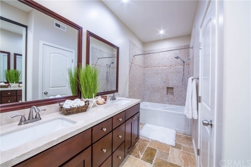 Remodeled Master bathroom with Wood Cabinet and Mabel Counter top