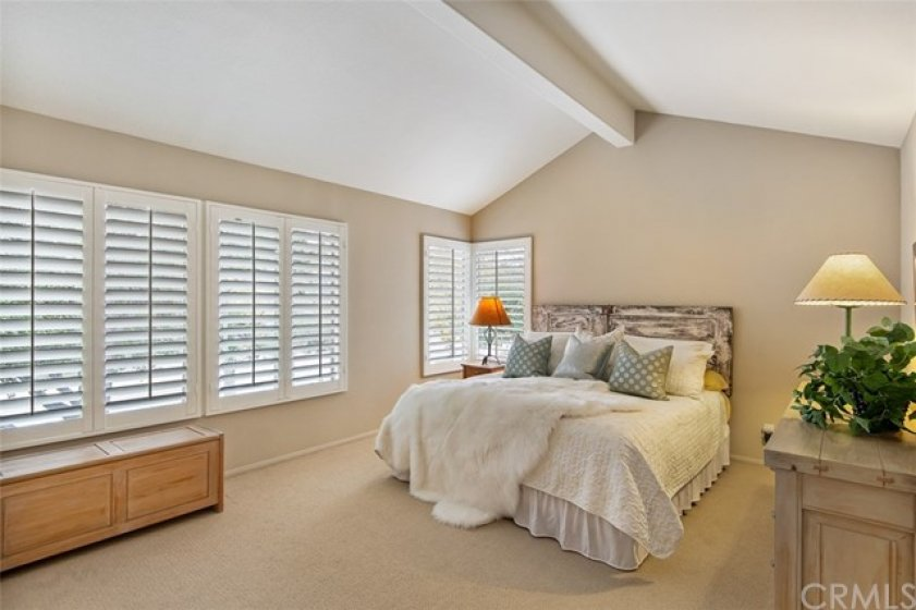 Spacious Master Bedroom features vaulted ceilings, plantation shutters, new carpet, new paint, and unobstructed views of the canyon.