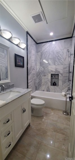 Guest Bath with marble shower and high end fixtures